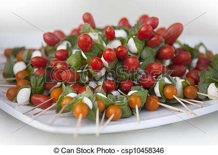 Stock Photo of Plate of Tomato Mozzarella Skewers.