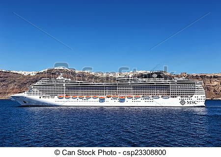 Stock Photography of MSC Fantasia cruise ship near Santorini.
