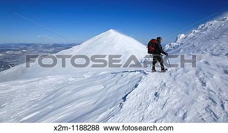 Pictures of Hiker in extreme weather conditions along the.