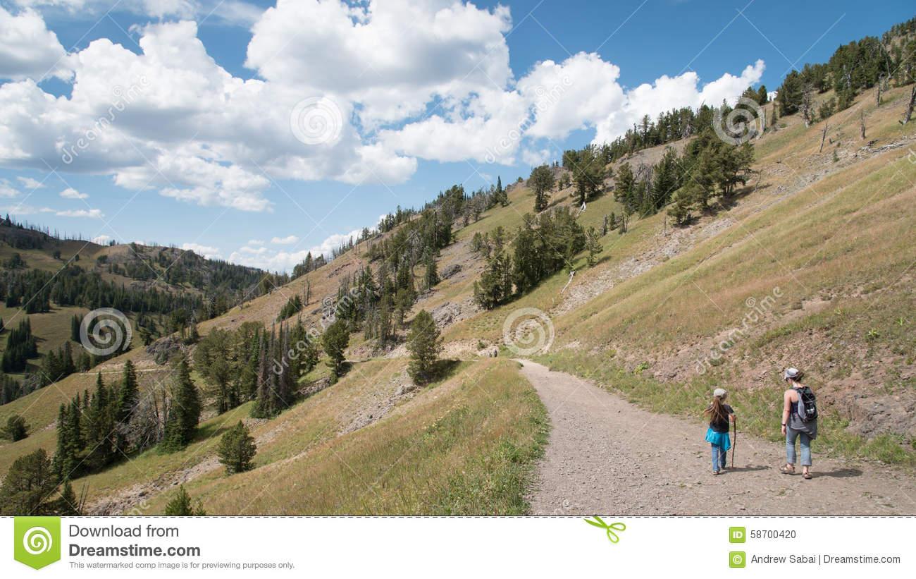 Girls On Mountain Hiking Trail Stock Photo.