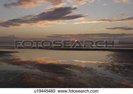 Stock Photo of Sunset over tide pools and mud flats Donna Nook.