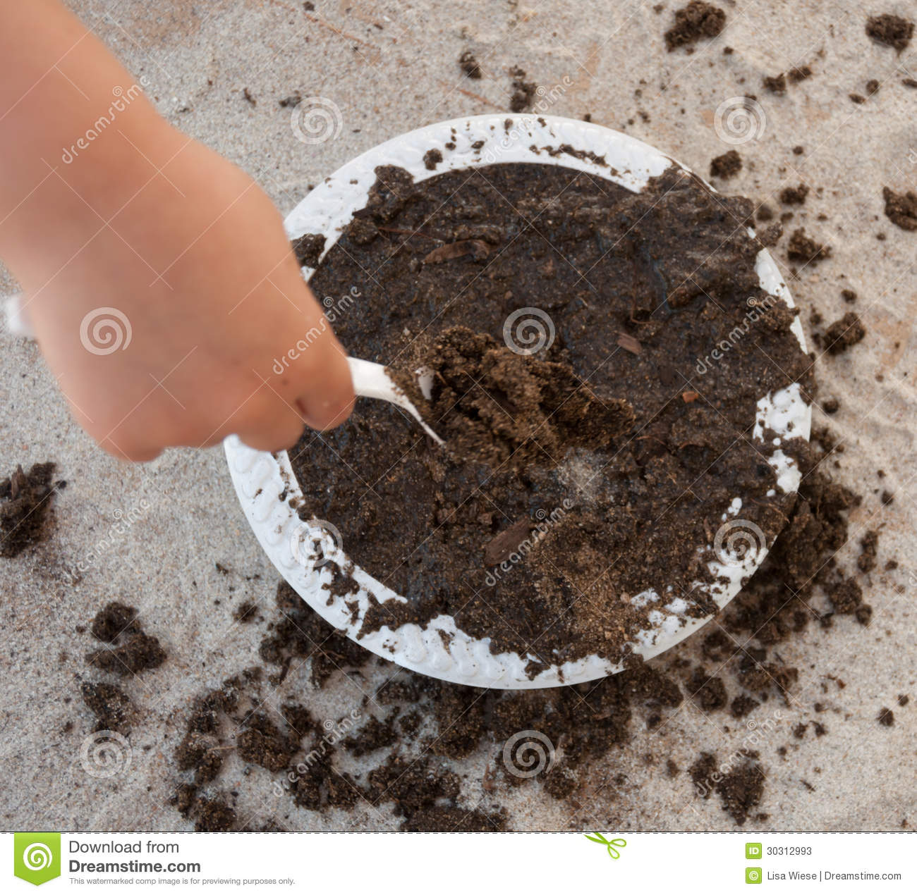 Child Playing With A Mud Pie Stock Photos.
