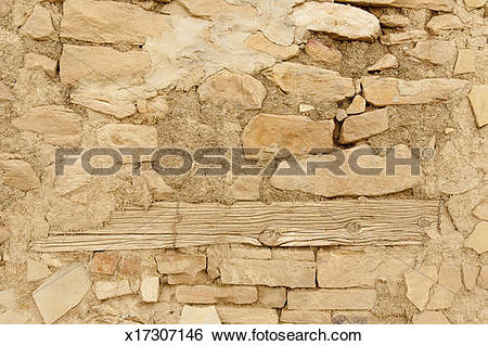 Stock Images of Wall made of stone, mud and wood x17307146.