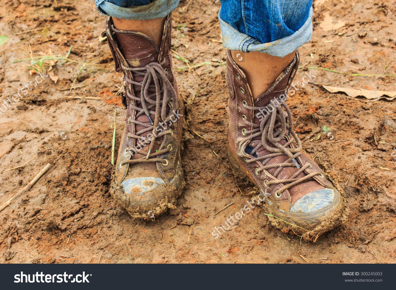 Muddy Feetshoes Walking Through Mud Stock Photo 300245003.
