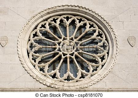 Stock Photography of Rose window of Muggia cathedral.
