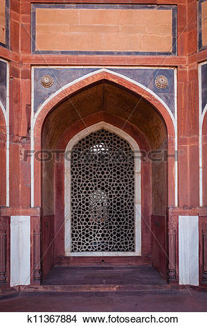 Stock Photo of Arch with carved marble window. Mughal style.