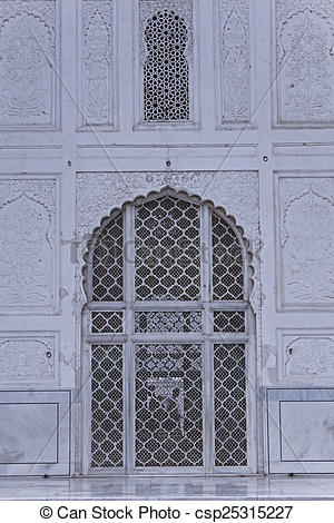 Stock Photo of Arch with carved marble window, Mughal style at the.