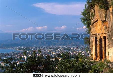 Stock Photo of Old ruins of tower overlooking city, Mugla, Turkey.
