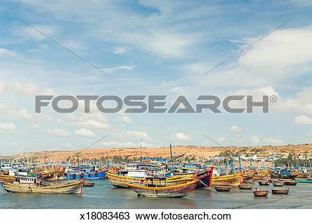 Stock Photo of Colourful wooden fishing boats at Mui Ne, Vietnam.
