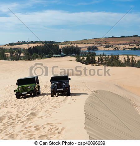 Stock Photos of off road car vehicle in white sand dune desert at.