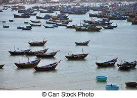 Stock Photography of Fishermen in Coracles, Mui Ne, Vietnam.
