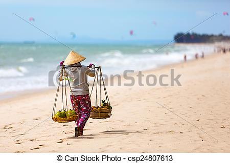 Stock Photography of Vietnamese woman selling Fruits at Mui Ne.