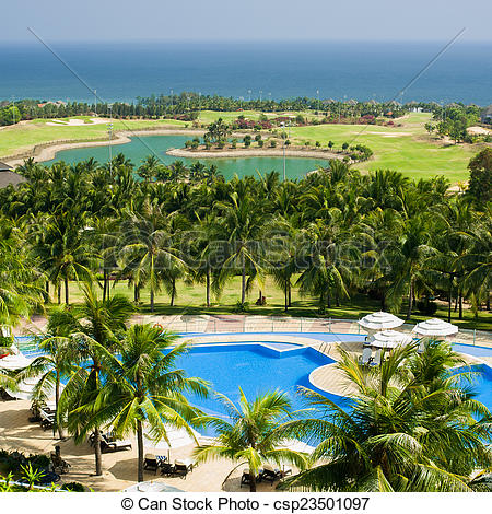 Stock Photographs of Tropical lhotel with swimming pool and golf.