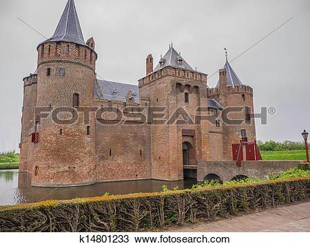 Stock Photo of Dark sky over Muiderslot Castle in the Netherlands.
