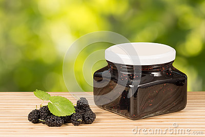 Mulberry Jam In Jar And Some Fresh Fruits And Leaves On Table.