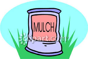 Bag of Mulch Sitting In Grass.