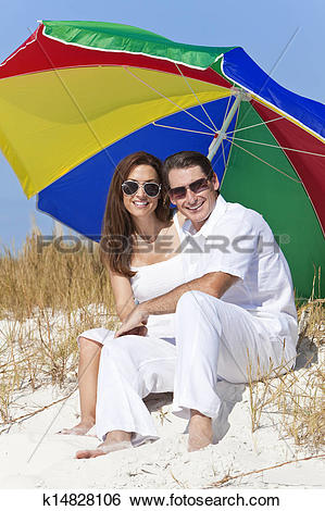 Stock Images of Man Woman Couple Sunglasses Multi Colored Beach.