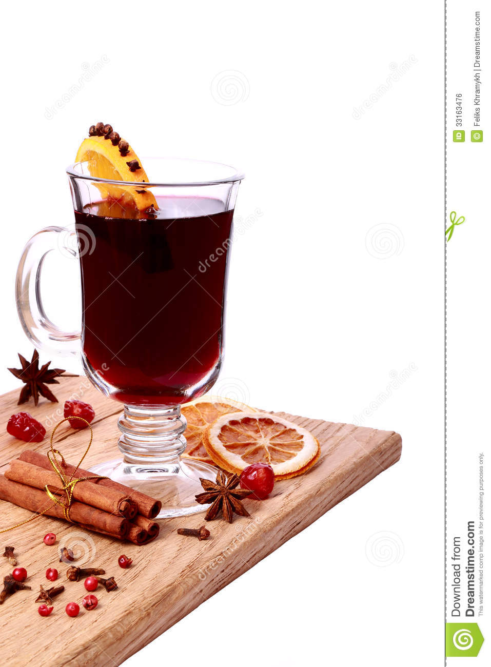 Glass Of Mulled Wine And Ingredients On A Wooden Table Royalty.