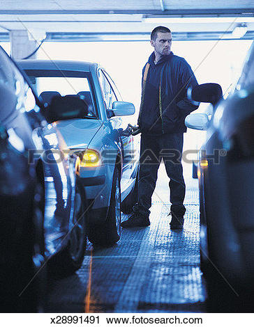 Stock Photography of Man Committing a Car Theft in a Multi Storey.