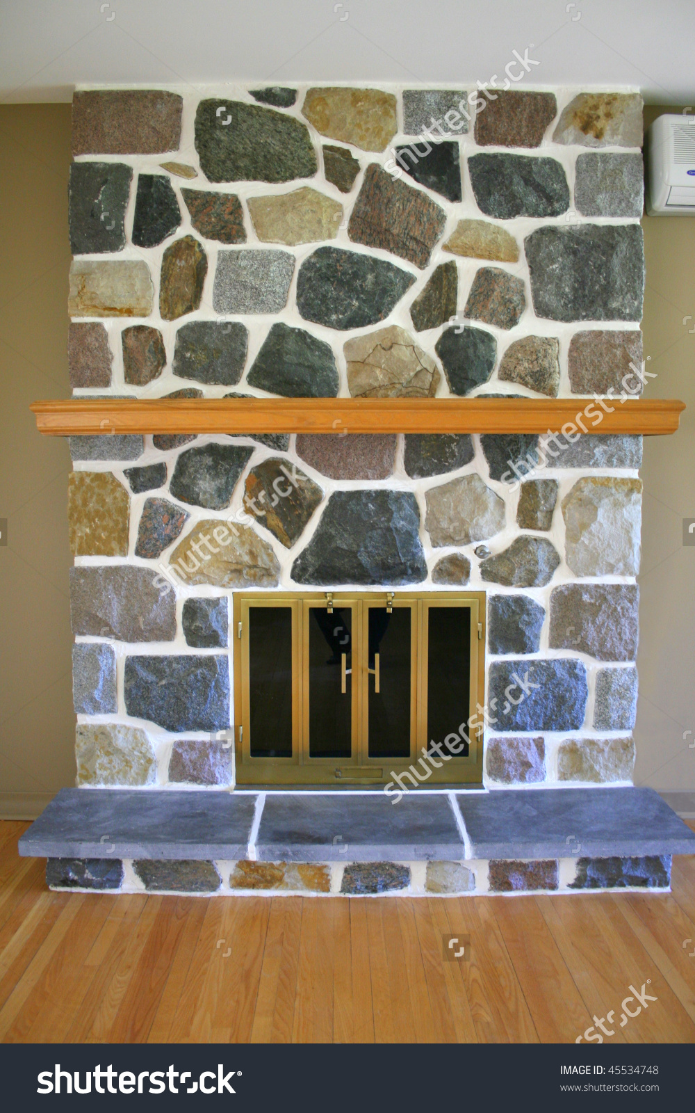 Multi Colored Stone Fireplace Wood Mantle Stock Photo 45534748.
