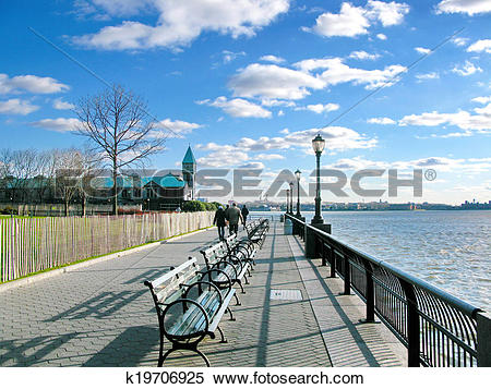Stock Image of New York City: Battery Park sidewalk on a sunny day.