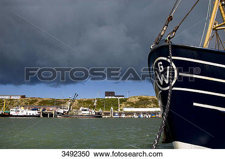 Stock Photography of Thunderclouds above the harbour of Hoernum.