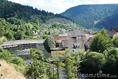 Roofed Wooden Bridge In The Black Forest Stock Photo.
