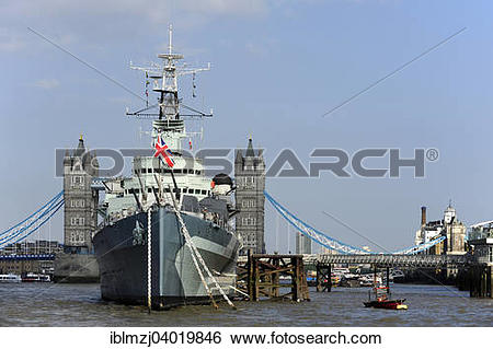 "Stock Images of ""Tower Bridge behind the HMS Belfast museum ship."