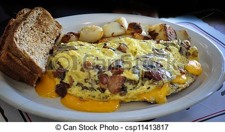 Stock Photography of egg, ham and mushroom omelet with toast and.