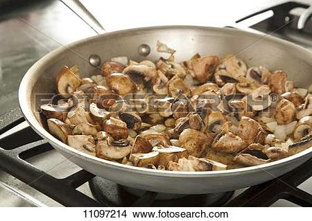 Stock Photo of Mushrooms and Onions Cooking in a Skillet 11097214.