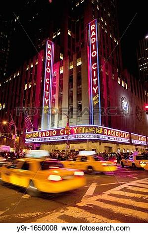 Pictures of Taxis drive by Radio City Music Hall in Manhattan, New.
