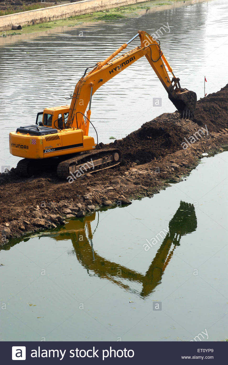 Reflection Excavator Stock Photos & Reflection Excavator Stock.