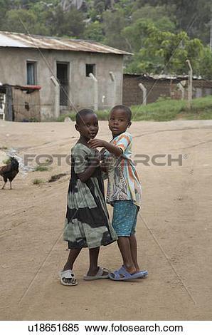 Stock Image of people child children kid tanzania girls mwanza.