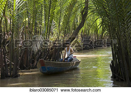 "Stock Photography of ""Boatman on a tributary of the Mekong Delta."