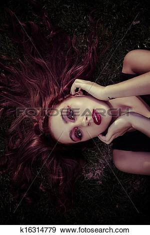 Stock Photograph of Beauty Romantic Girl Outdoor. Toned in warm.