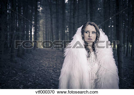 Stock Photography of Portrait of a white dressed mystic woman in a.