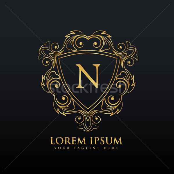 letter N logo design with flourish decoration vector.