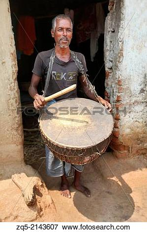 Picture of Tribal musician playing a traditional musical.