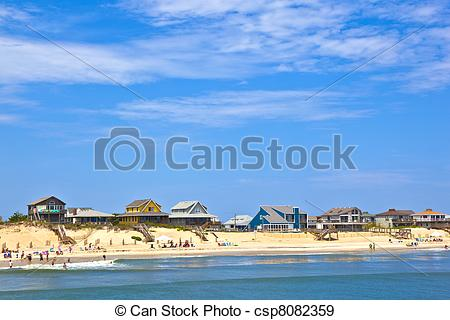Stock Photographs of beach with cottages at Nags Head in the outer.