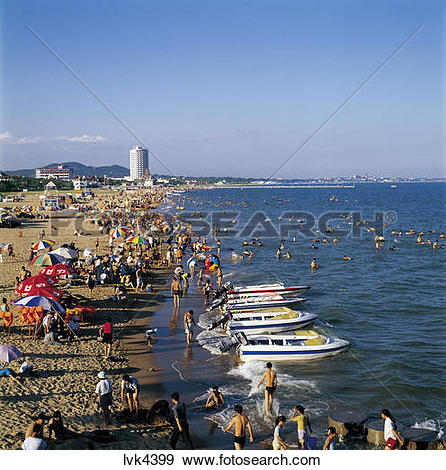 Stock Photograph of crowd on beach,Nandaihe,Qinhuangdao,Hebei.