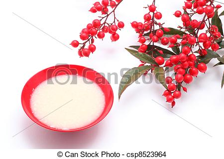 Stock Photo of Japanese sweet mild sake and nandina domestica.