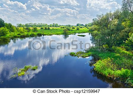 Stock Photo of Spring landscape with Narew river and clouds on the.