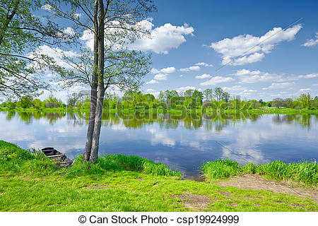 Stock Photographs of The Narew River Scenery. Old boat on.