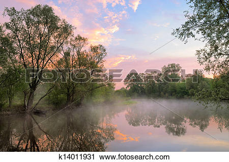 Stock Photography of Fog and warm sky over the Narew river, Poland.