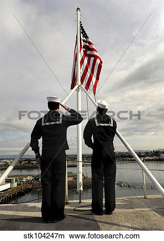 Stock Photo of Sailors raise the national ensign aboard USS.