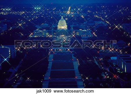 Stock Photograph of The U.S. Capitol and National Mall at night as.