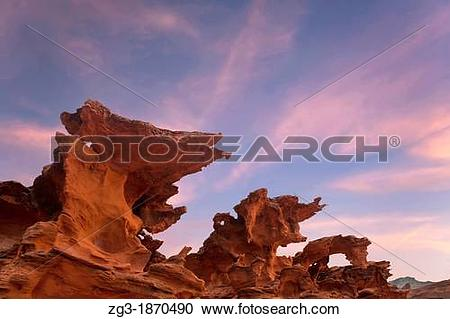 Stock Photography of Sunset at Devils Fire, Strange eroded.