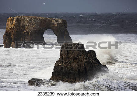 Stock Photograph of Rock formations and a natural arch in the.