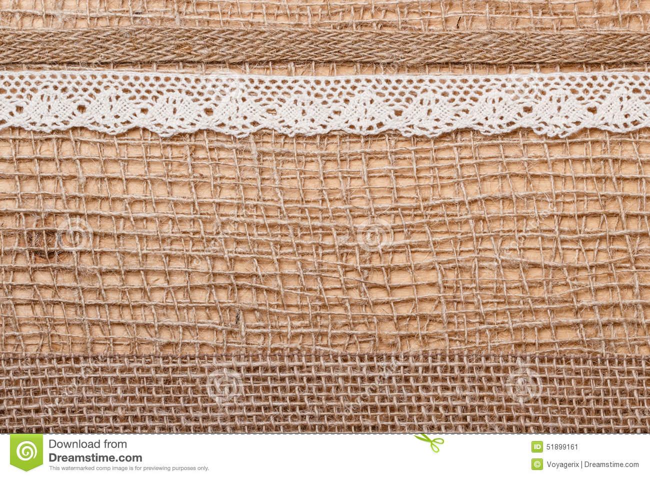 Jute Bagging Ribbon On Brown Mesh Material Natural Burlap.