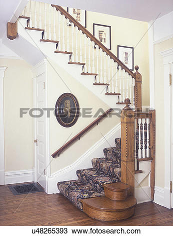 Stock Photo of STAIRWAYS: Restored Victorian home, natural stained.